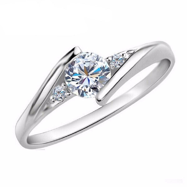 White Gold Plated Crystal Engagement Ring - Embrace Luxury