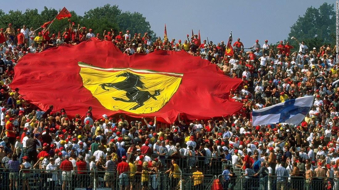 Numerous tifosi - Ferrari fans - with a large flag at the Monza circuit
