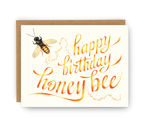 birthday greeting card and kraft envelope featuring bee and typography
