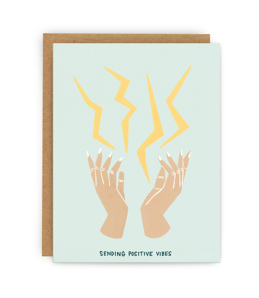 love and support greeting card with kraft envelope featuring pair of hands shooting lighting bolts and typography