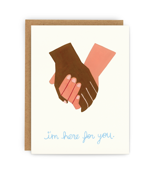 support greeting card and kraft envelope featuring pair of holding hands and 'here for you' typography