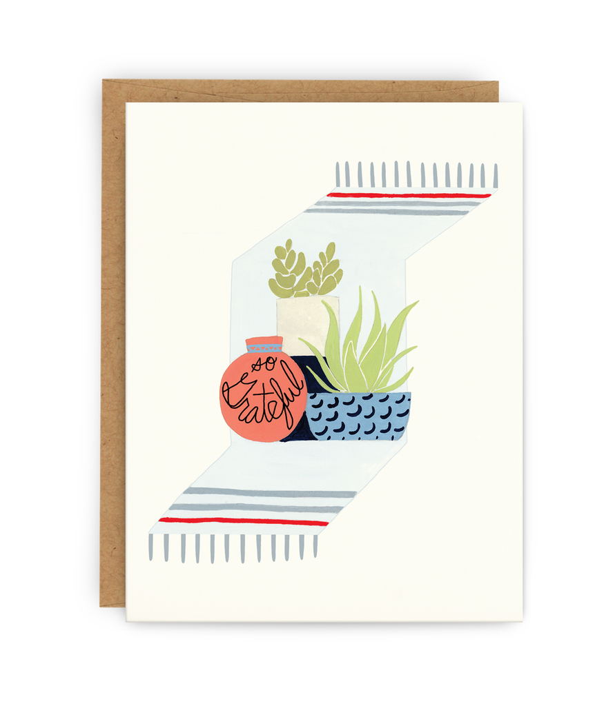 thank you greeting card and kraft envelope featuring blanket, potted plants and typography