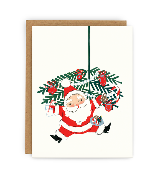 christmas greeting card and kraft envelope featuring santa with milk and cookies
