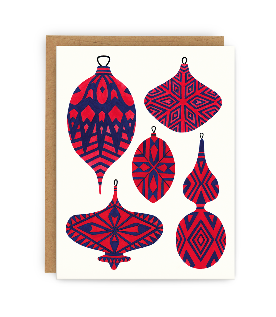 christmas greeting card and kraft envelope featuring ornaments covered in different vintage patterned designs