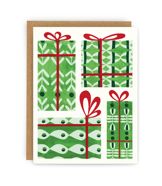 christmas greeting card and kraft envelope featuring presents covered in different patterned designs