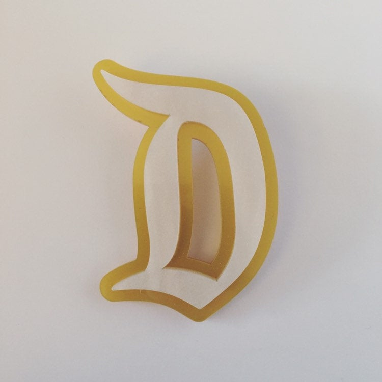"Flare Layered Gothic ""D"" Brooch in White Pearl over Gold Satin"