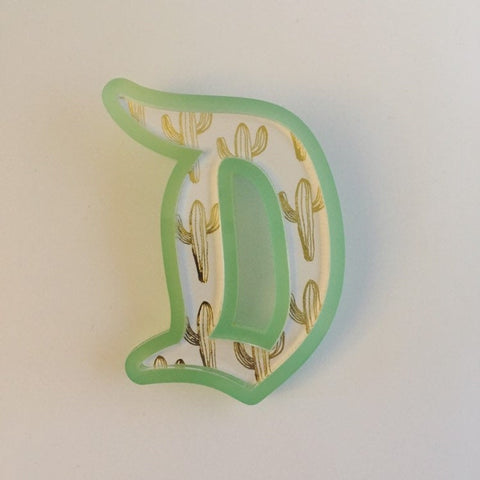 "Flare Printed Gothic ""D"" Brooch in Green with Gold Cactus"