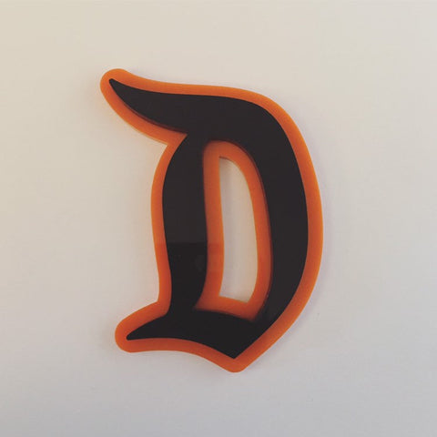 "Flare Layered Gothic ""D"" Brooch in Black over Orange"