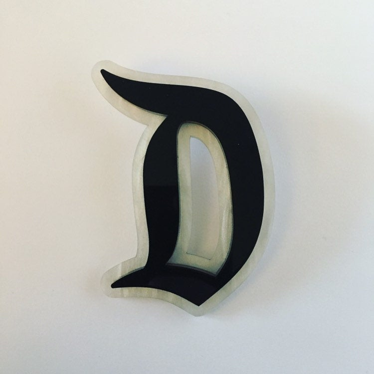 "Flare Layered Gothic ""D"" Brooch in Black over White Pearl"