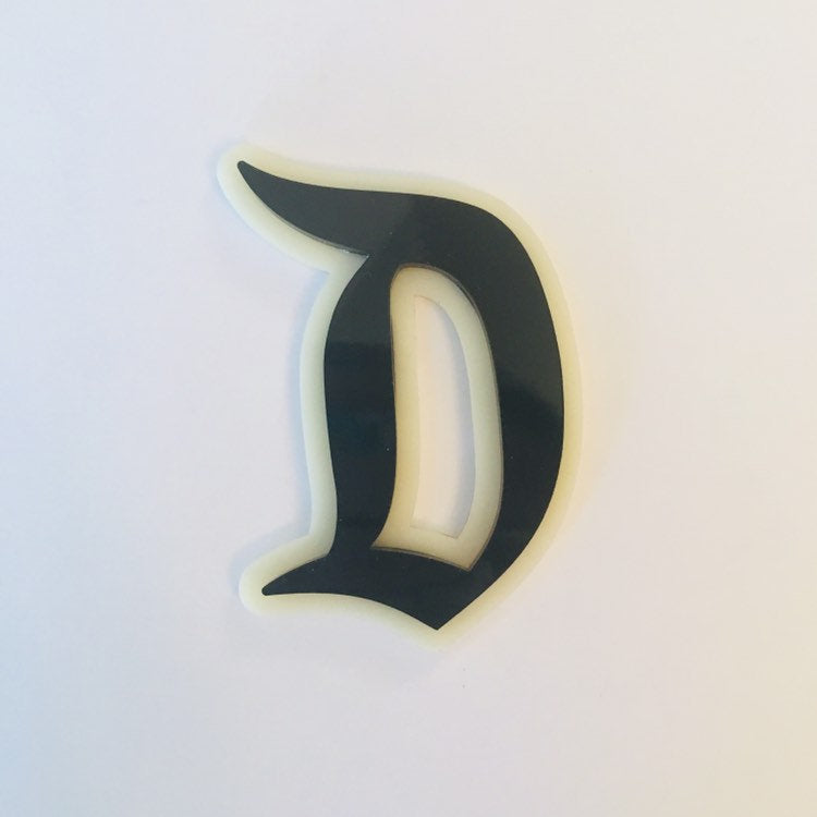 "Flare Layered Gothic ""D"" Brooch in Black over Ivory"