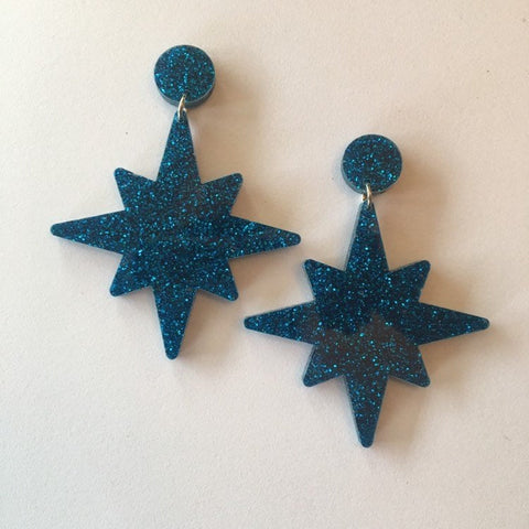 Flare Starburst Dangler Earrings in Blue Glitter