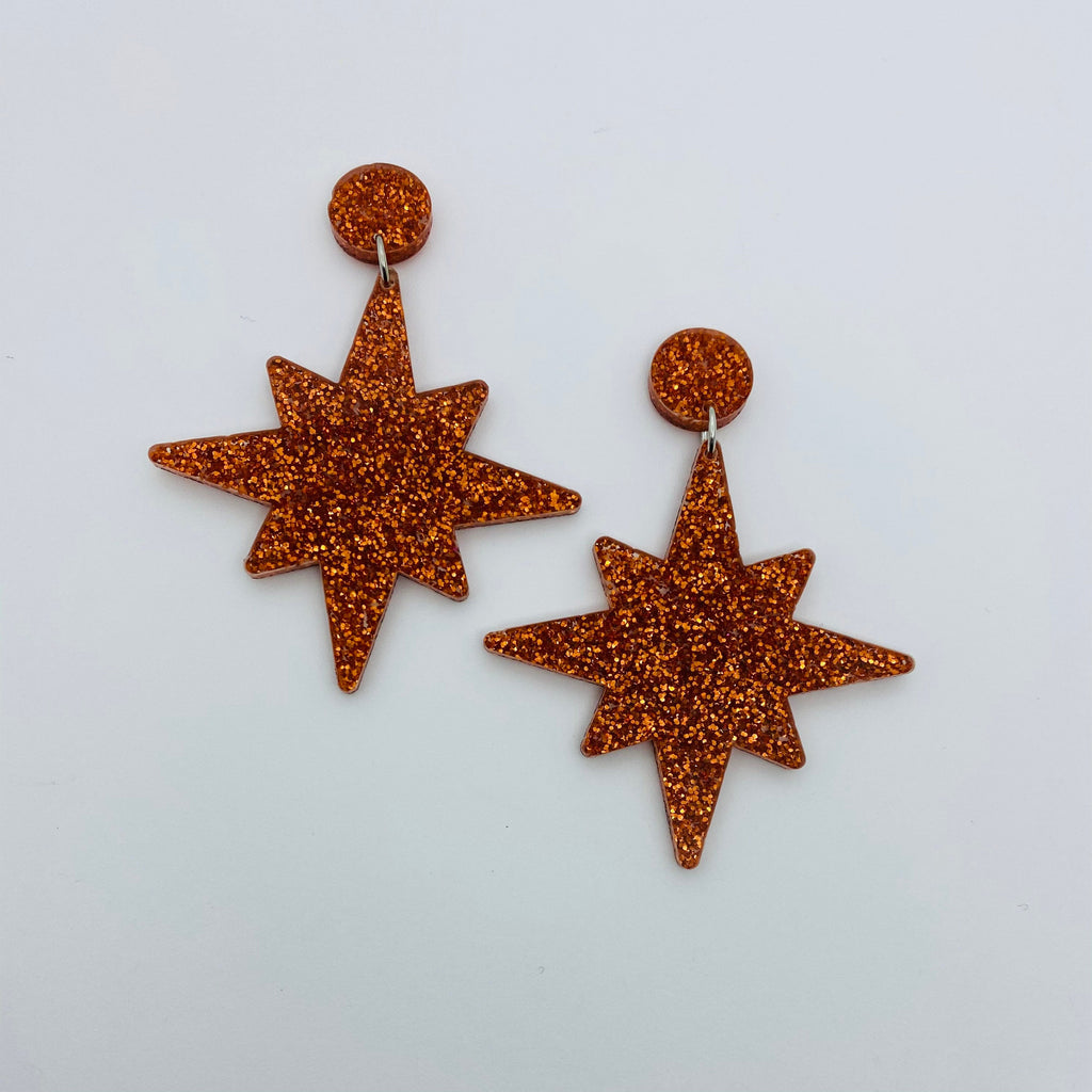 Flare Starburst Dangler Earrings in Orange Glitter