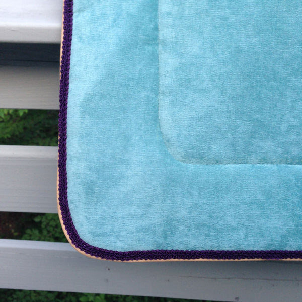 turquoise saddle pad with purple trim