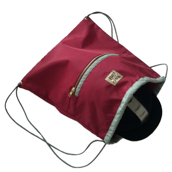 Burgundy helmet sling bag
