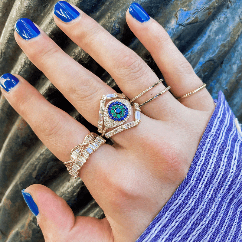 Evil Eye Protector Ring with Sapphires, Emeralds, and Diamonds on hand