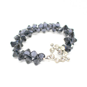Blue-grey stone bracelet with delicate crystal clasp.
