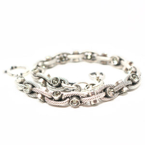Beautiful chain link bracelet with delicate crystal inserts. Great as a statement piece or holiday gift!