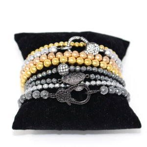stackable bead bracelets in gold, copper, silver, and pewter
