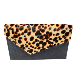 This gorgeous bag features genuine black leather paired with a calf hair leopard print