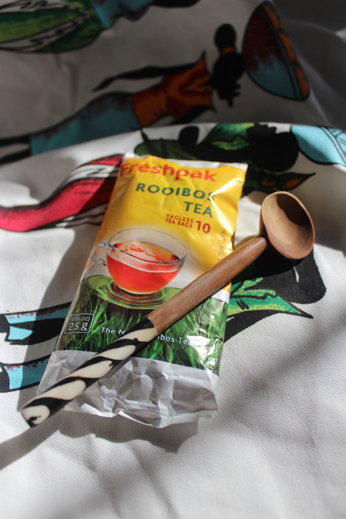 Rooibos Tea and marble tipped wooden spoon