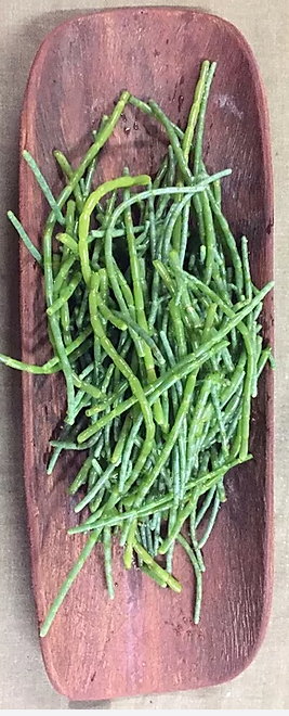 Samphire (Aussie Sea Asparagus) with vibrant green fleshy stalks and finger-like leaves. It has a distinctively crisp and salty flavour. This unique vegetable, to be used steamed, in stir-frys or blanched, and used as a bed under seafood.