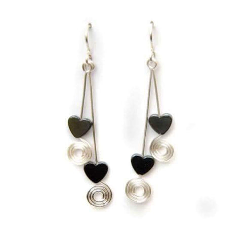 Double drop hematite heart earrings with coils, on sterling silver earwires.