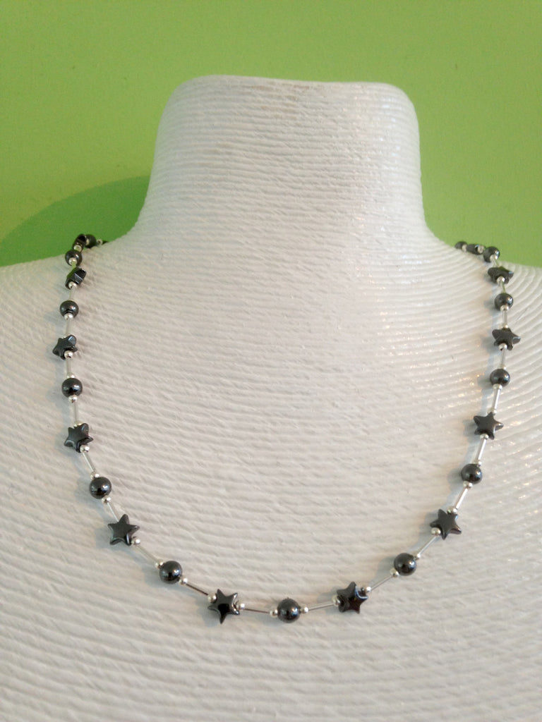 Silver and hematite star necklace. 18 inches in length.