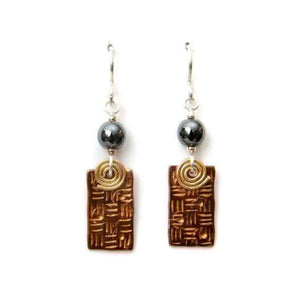 Copper textured earrings with coils.