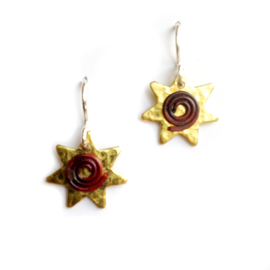 Brass star earrings with copper coil centre.