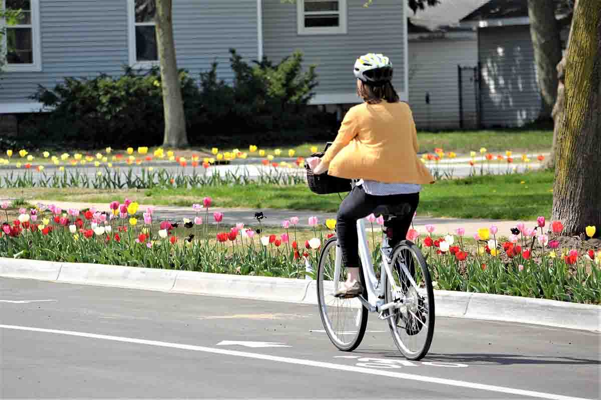 Woman riding bike down the road