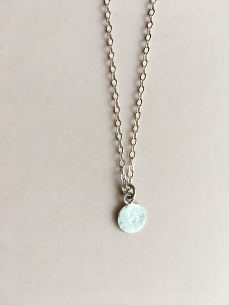 tiny lullaby moon necklace in sterling silver