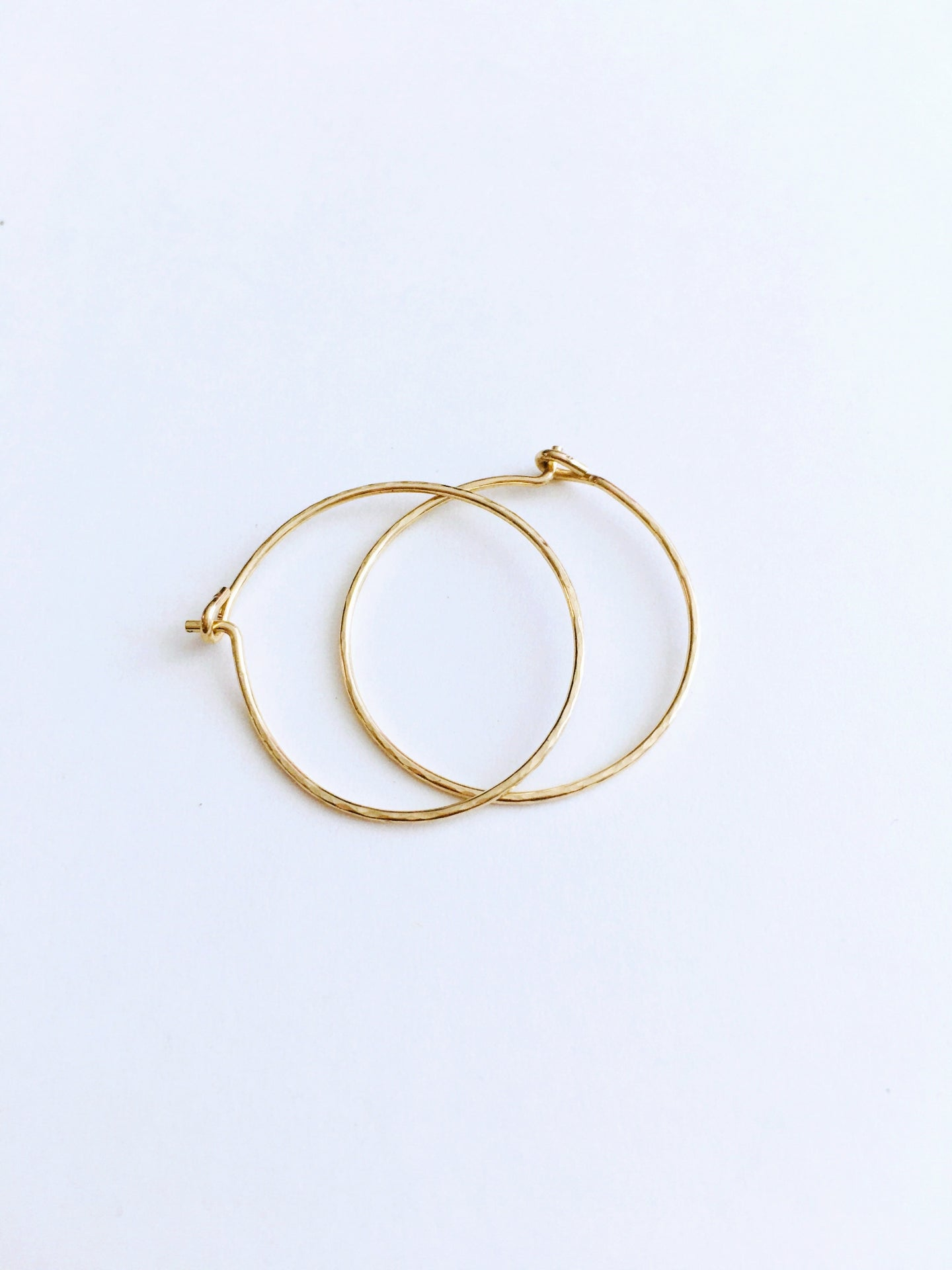 magic dust hoop earrings in gold + silver