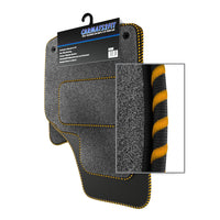 View of a collection of Tailored custom car mats, specifically Aston Martin DB9 (2004-2012) Custom Carpet Car Mats