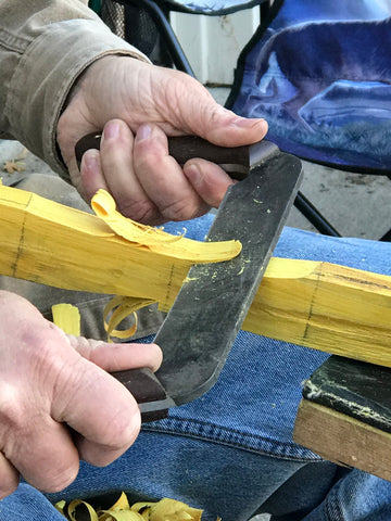 Using a draw knife to remove material from the bow