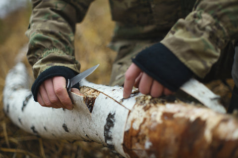 Using a Survival Knife to scrape bark
