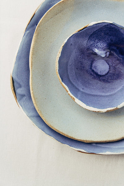 Hana Karim Ceramics handmade tableware, colorful plates, minimal table setting, blue tabletop inspiration