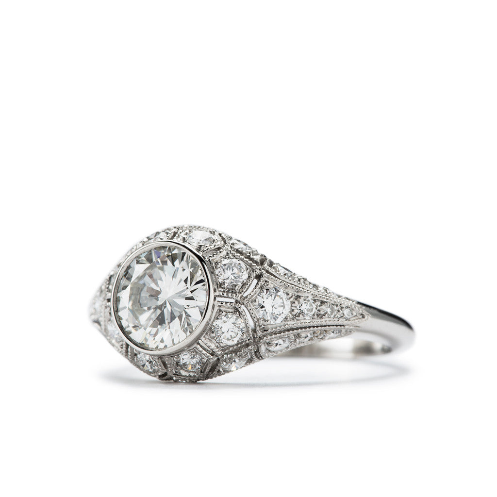 Antique style platinum engagement ring by French Master Jeweler