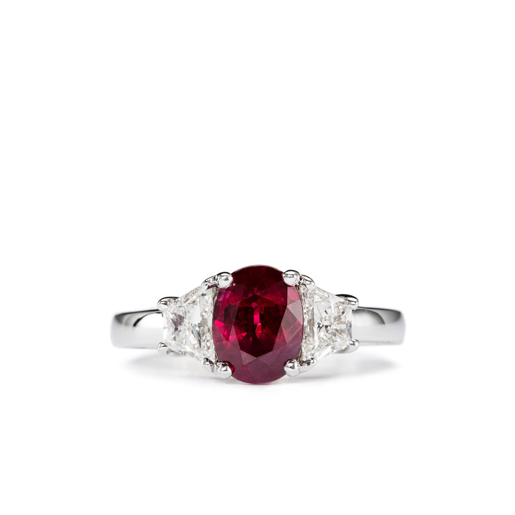 Natural Deep Red Ruby Flanked by Two Finely Cut Trapezoid Diamonds.