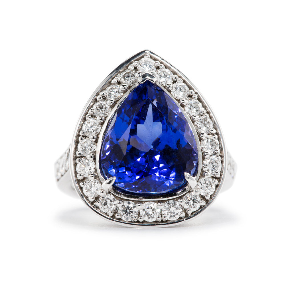 Dramatic Tanzanite Ring centered on a 7.10ct Pear Shaped Natural Tanzanite and accented with 1.20ctw Diamonds.
