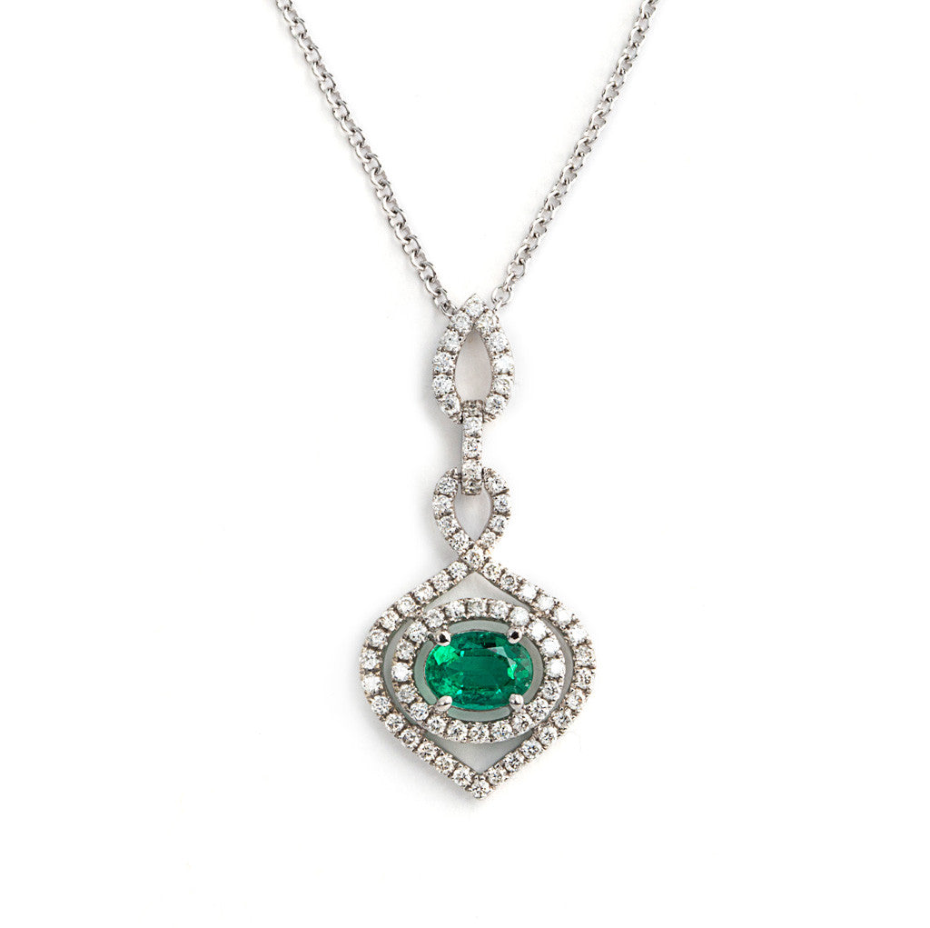'Thread' style pendant of diamonds centered on a rich green natural Emerald.