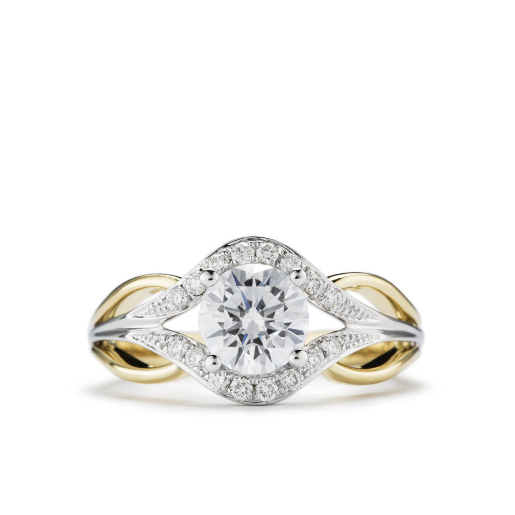 Two-tone diamond engagement ring with split shank and diamond accents