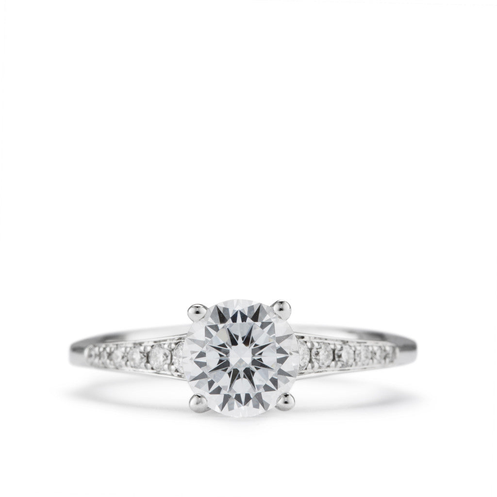 """Tiara""  Cathederal style diamond engagement ring."