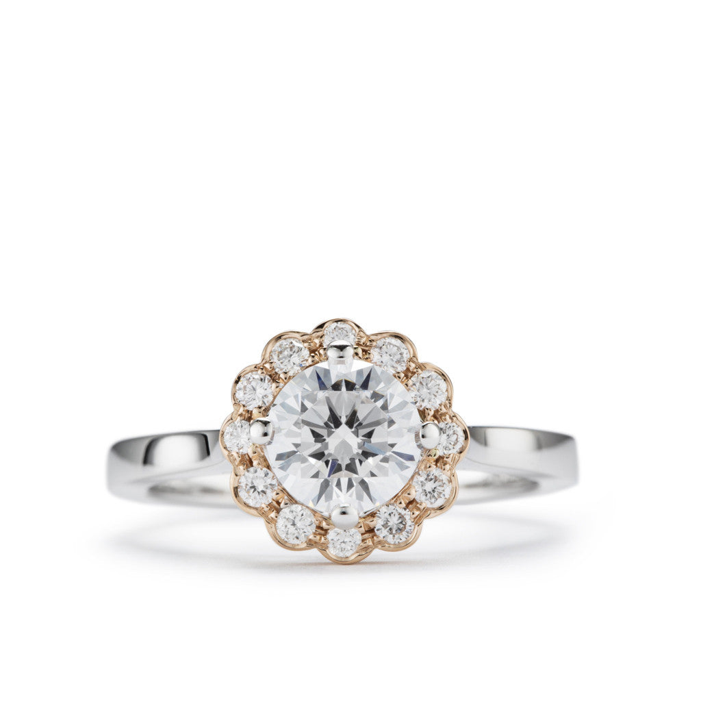 'Daisy' two tone diamond halo engagement ring.