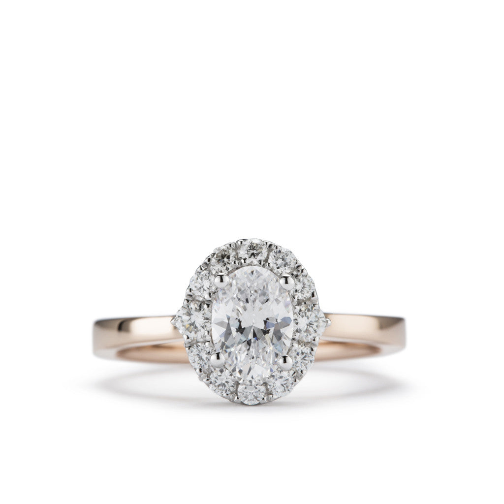 Whimisical crown style diamond halo engagement ring centered on an oval diamond 'Felicity'