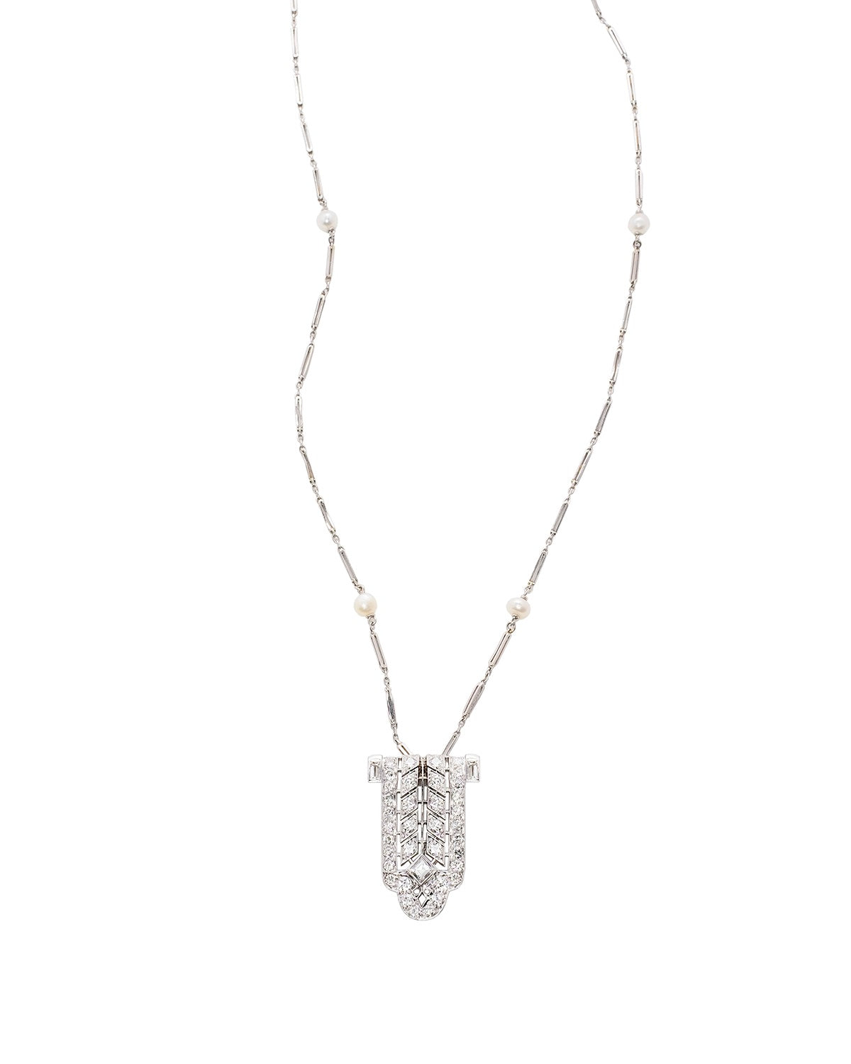 Art Deco Pendant in Platinum and Diamond with Pearl accents.