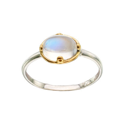 A delicate moonstone ring done in 18K yellow gold and sterling silver.