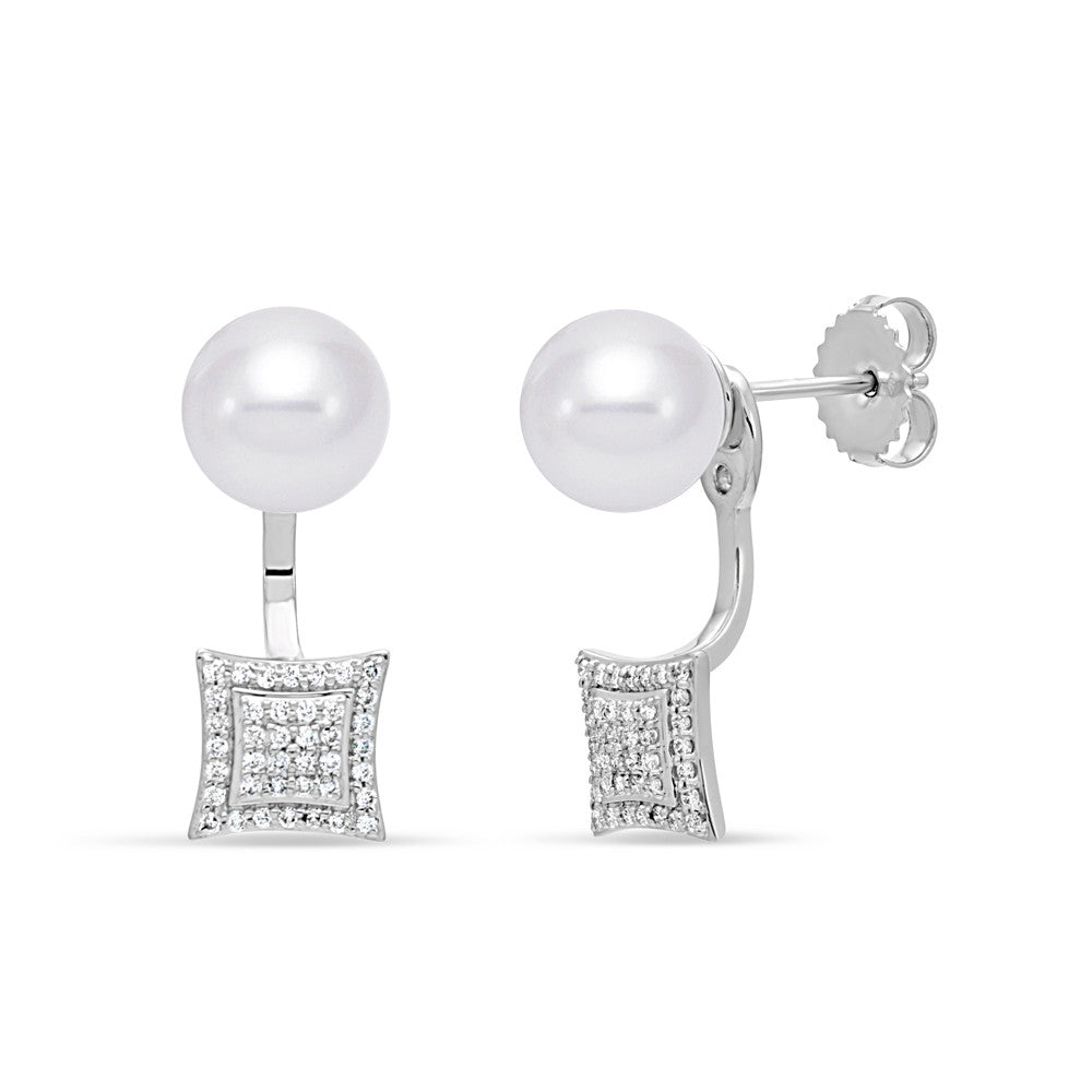 Unique pearl stud earrings with dramatic diamond accent drop.