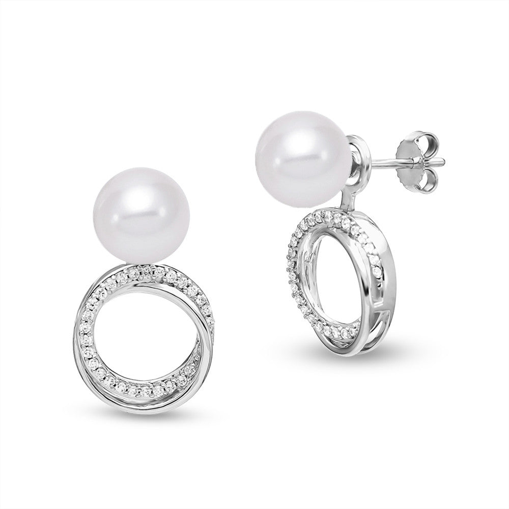 A quick twist makes these white gold and pearl studs into a clever drop.