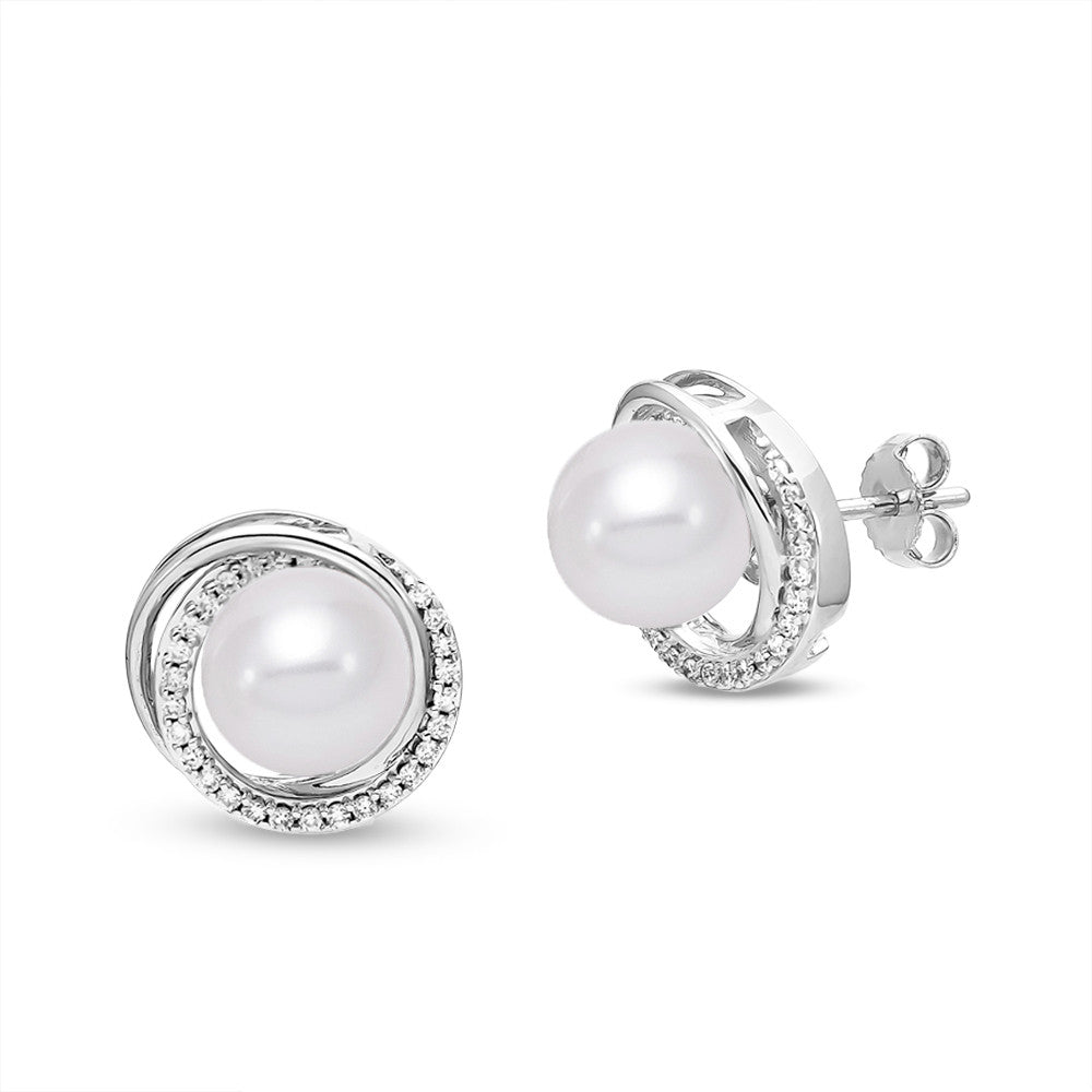 Convertible Pearl Earrings in 18k White Gold with diamond accents. The white gold swirl around the pearl converts to a dramatic drop beneath the classic pearl stud.