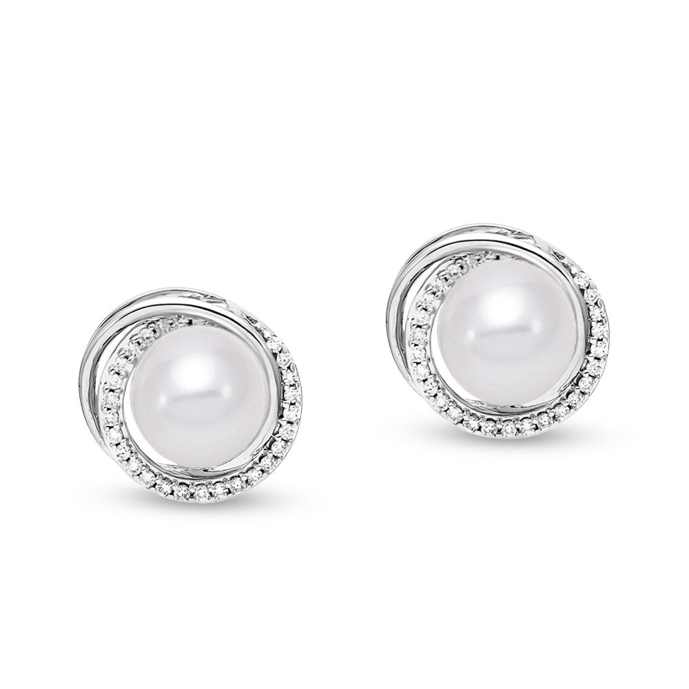 Convertible pearl studs with white gold and diamond surround that converts to a drop.